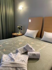 Кровать или кровати в номере Отель Ева