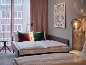 A bed or beds in a room at Adina Apartment Hotel Nuremberg