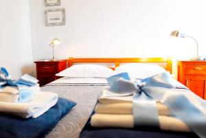 A bed or beds in a room at Beachfront Apartment Mala Tereza