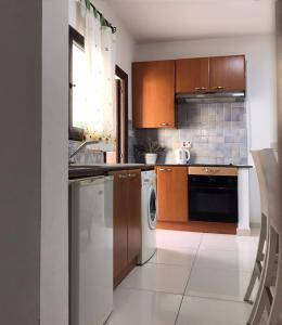 A kitchen or kitchenette at Royal Sunset Studios & Apartments