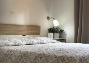 A bed or beds in a room at Royal Sunset Studios & Apartments