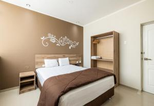 A bed or beds in a room at Hotel Solec Piura