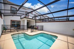 The swimming pool at or close to B - New 4 Bedroom Home - 5 Miles to Disney - Free Water Park - Private Pool