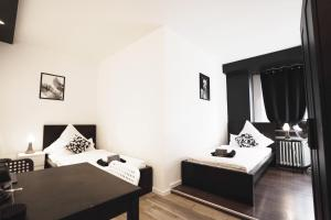 A bed or beds in a room at BLK Hostel