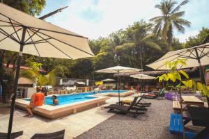 The swimming pool at or near Selina Santa Teresa North