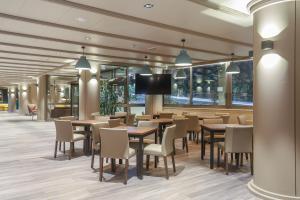Un restaurante o sitio para comer en Hotel Panorama