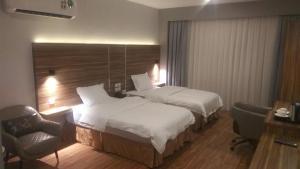 Cama ou camas em um quarto em SAS RTL Hotel