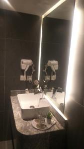 Um banheiro em SAS RTL Hotel