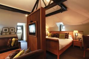 A bed or beds in a room at Hotel Du Vin & Bistro York