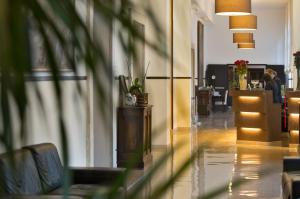 The lobby or reception area at Excel Roma Montemario