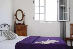 Een bed of bedden in een kamer bij Villas del Mar