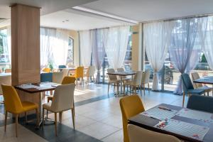 A restaurant or other place to eat at Belvedere Hotel - All inclusive