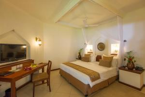 A bed or beds in a room at Sea Cliff Resort & Spa