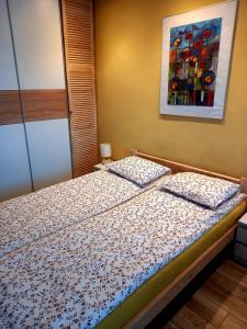 Łóżko lub łóżka w pokoju w obiekcie Modern Studio 9