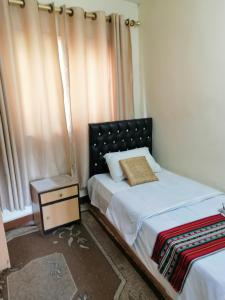 A bed or beds in a room at Hamoudah Hotel