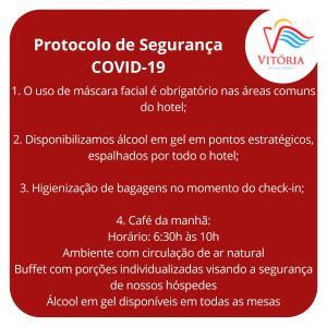 Um certificado, prêmio, placa ou outro documento exibido em Vitória Praia Hotel