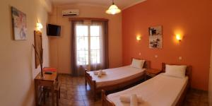 A bed or beds in a room at Elli Marina Studios and Apartments