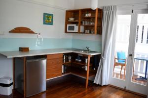 A kitchen or kitchenette at Floriana Guest House