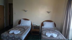 A bed or beds in a room at Semiramis Hotel Alexandria