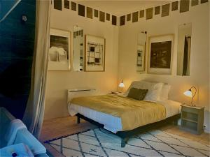 A bed or beds in a room at The Good House