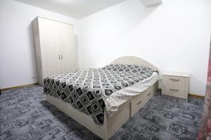 Кровать или кровати в номере Apartament Luxury