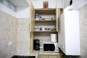 Кухня или мини-кухня в Apartament Luxury