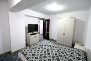 Телевизор и/или развлекательный центр в Apartament Luxury