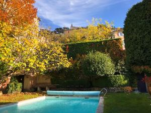 The swimming pool at or near Le Clos Du Buis