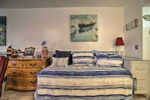 A bed or beds in a room at Sunny Hollywood Hideaway - 200 Feet to Beach!
