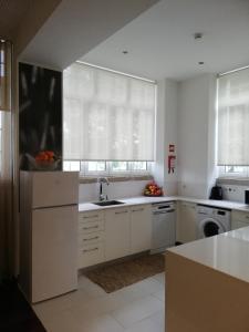 A kitchen or kitchenette at Casa de Perais