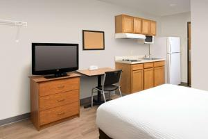 A television and/or entertainment center at WoodSpring Suites Orlando Clermont - Minneola