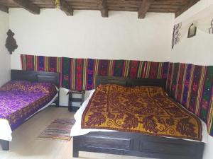 A bed or beds in a room at Satu Muscelean