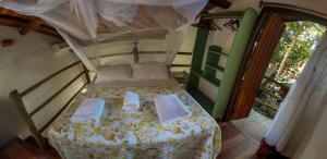 Cama ou camas em um quarto em Pousada Aldeia