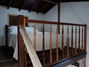 A bed or beds in a room at Pouso Frutos de Paraty