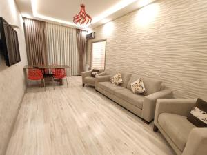 Uma área de estar em **Exclusive Apartment**