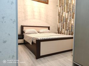 Cama ou camas em um quarto em **Exclusive Apartment**
