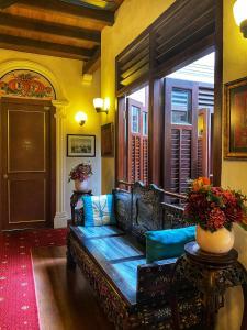 A seating area at Nam Keng Hotel Penang