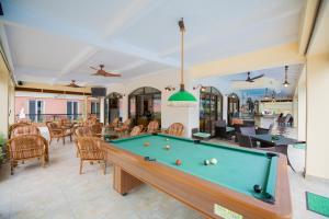A pool table at Maltezos Hotel