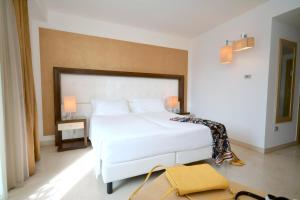 A bed or beds in a room at Vittoria Resort Pool & SPA