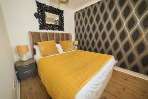 A bed or beds in a room at G Boutique Hotel