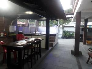 A restaurant or other place to eat at Suítes Paúba