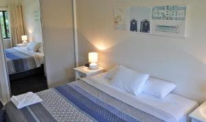 A bed or beds in a room at Angelwaters