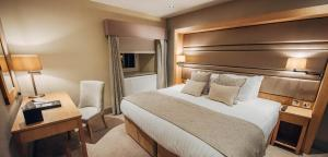 A bed or beds in a room at Bowfield Hotel & Country Club
