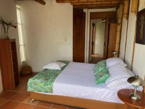 Кровать или кровати в номере Finca Agualinda