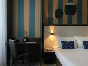 A bed or beds in a room at AV Boutique Hotel