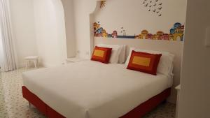 A bed or beds in a room at Hotel Le Terrazze