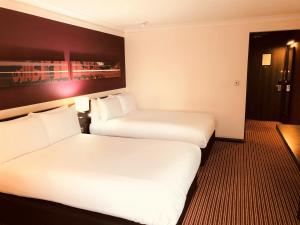 A bed or beds in a room at Crowne Plaza Birmingham City, an IHG Hotel