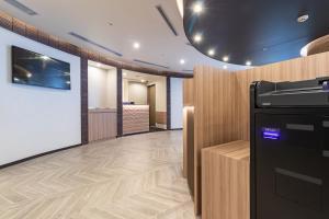 A television and/or entertainment center at Sotetsu Fresa Inn Yokohama Higashiguchi (Open from 25 October 2020)
