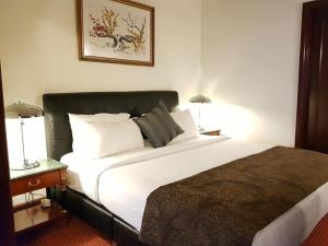 A bed or beds in a room at MANDRIA APARTMENT AT BERJAYA TIMES SQUARE