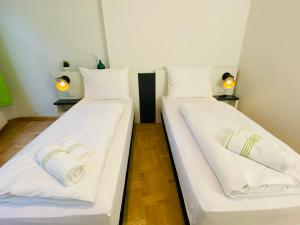 A bed or beds in a room at bestprice Hotel Aachen Hauptbahnhof